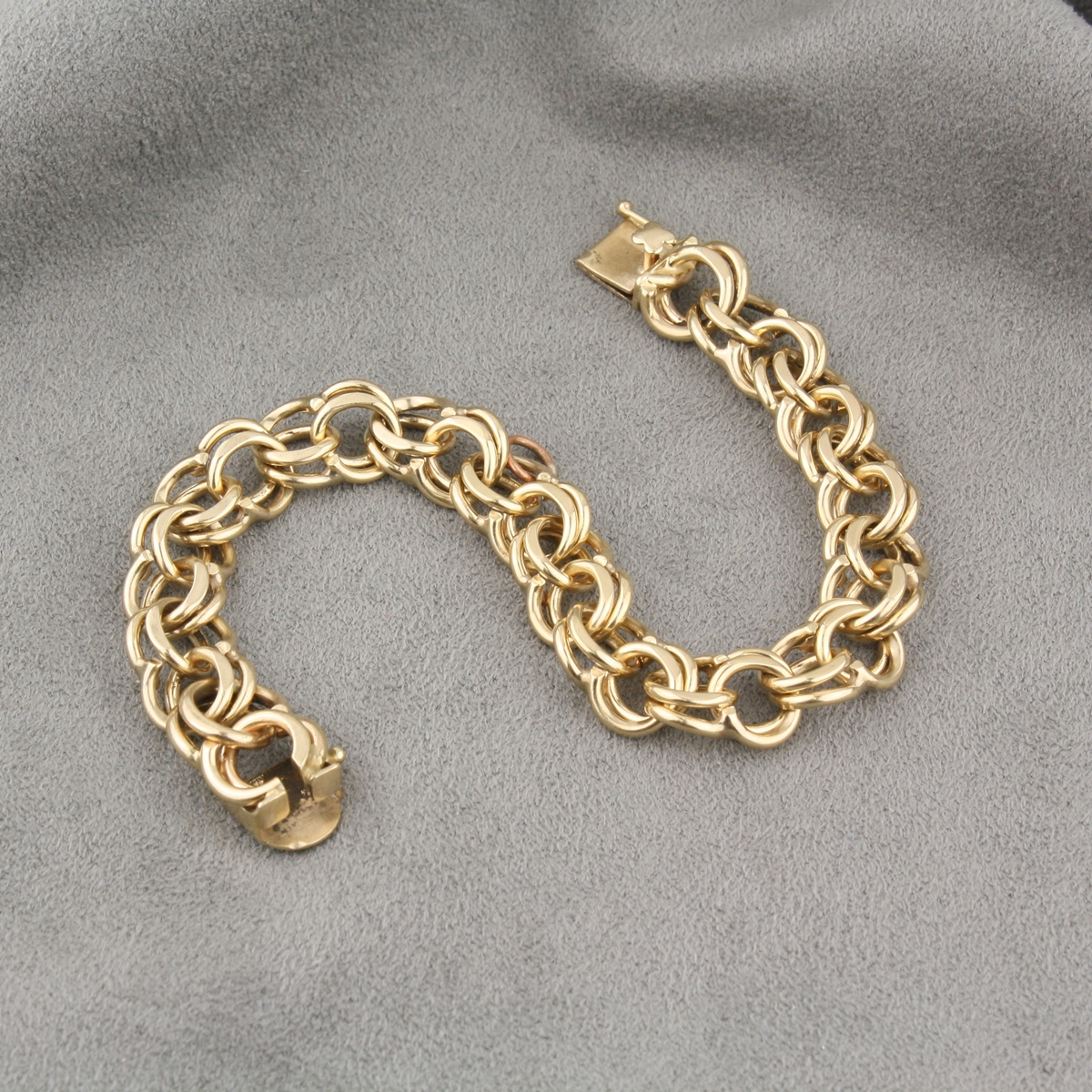 preowned 14 karat yellow gold charm bracelet