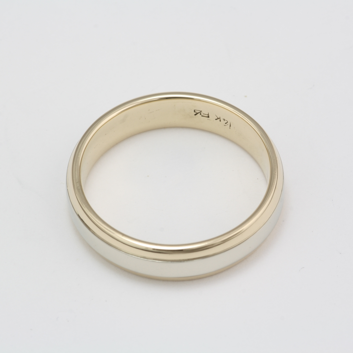 pre owned 14 karat white and yellow gold wedding band