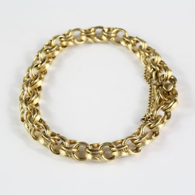 pre-owned-14-karat-yellow-gold-double-link-charm-bracelet-with-satin-or-polish-finish-on-each-link