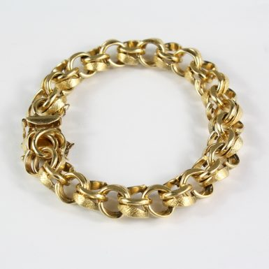 pre-owned-14-karat-solid-yellow-gold-double-link-curb-charm-bracelet