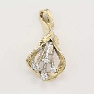 pre-owned-14-karat-yellow-white-gold-freeform-diamond-pendant