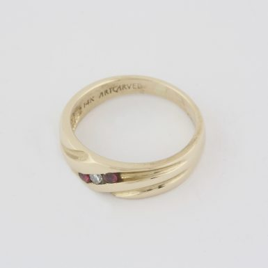 Pre-Owned 14 Karat Yellow Gold Diamond and Ruby Wedding Band