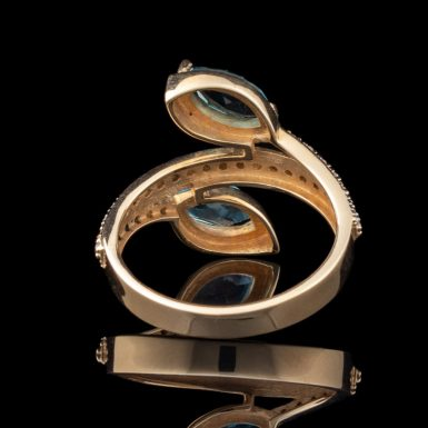 By-Pass Design 14K Blue Topaz and Diamond Ring
