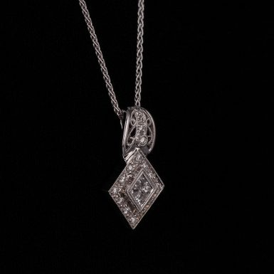 Pre-Owned 14K Diamond Pendant on 18 inch Wheat Chain