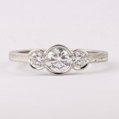 Pre-Owned Platinum VVS2 3-Diamond Bezel Set Ring With GIA Certificates